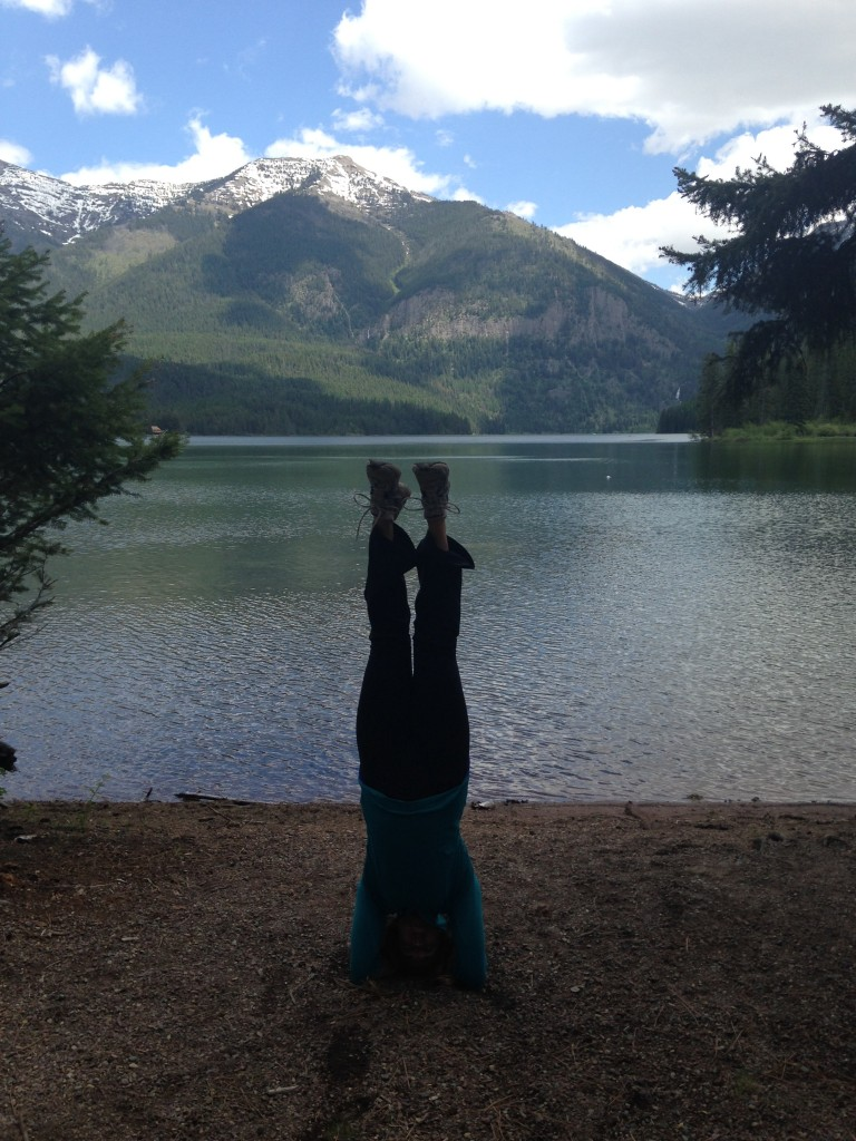 Kristin practicing yoga on the shore of Holland Lake.