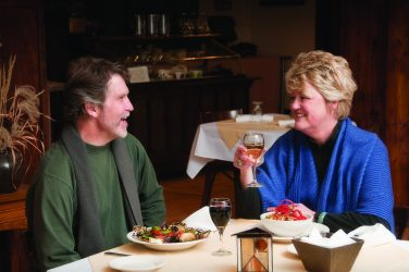A couple enjoys dinner at The Belton Chalet in West Glacier.