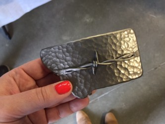 Fun fact: the barbed wire on this buckle is from a working Montana ranch.