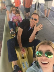 Riding the alpine slide at Whitefish Mountain Resort.