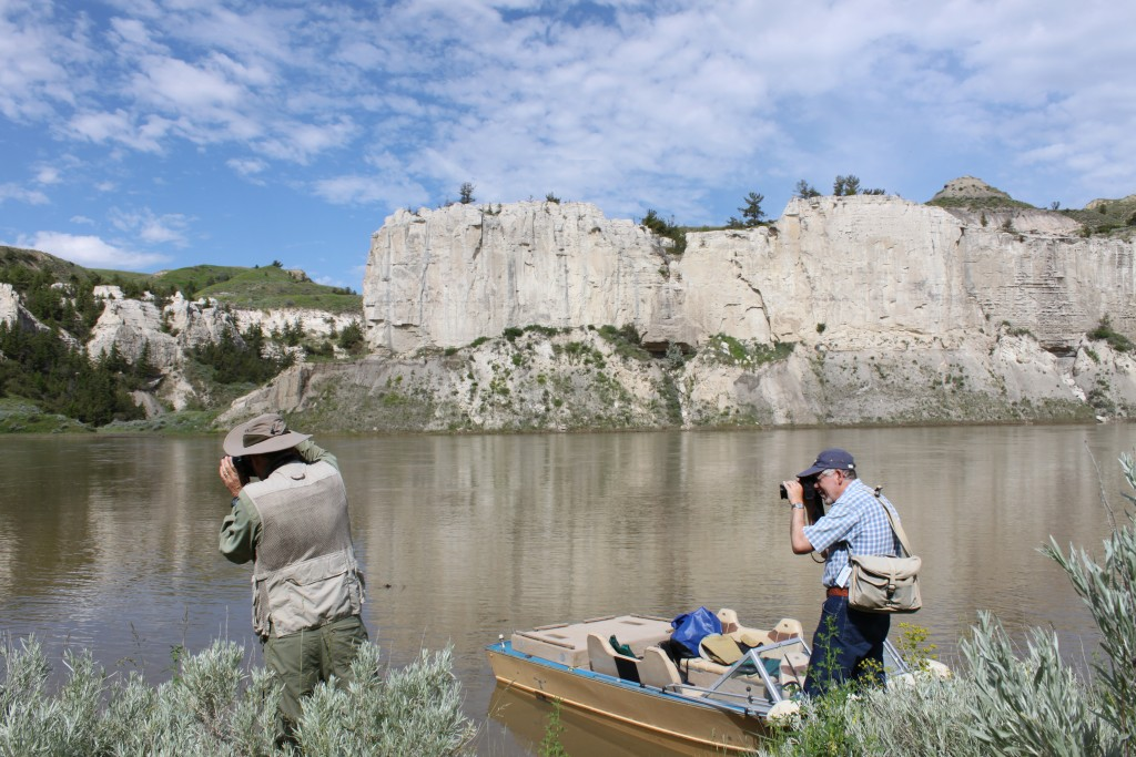 Boaters take photos along the White Cliffs.