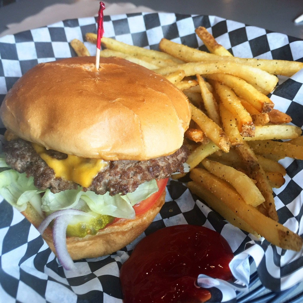 My order: a regular cheeseburger, fully loaded, with a small order of greek garlic fries. YUM.