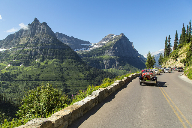 A red travels along the Going-to-the-Sun Road as part of the FDR commemorative trip in Glacier National Park. Photo: Glacier NPS Flickr/Jacob W. Frank