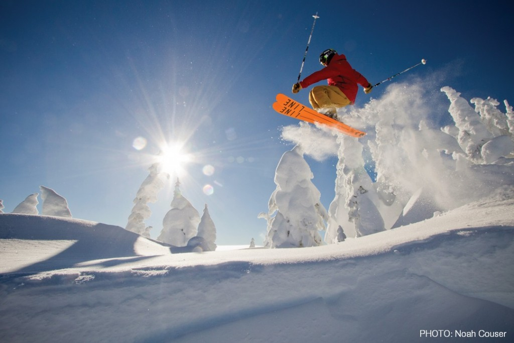 A skier catches air in Western Montana's Glacier Country. Photo: Noah Couser
