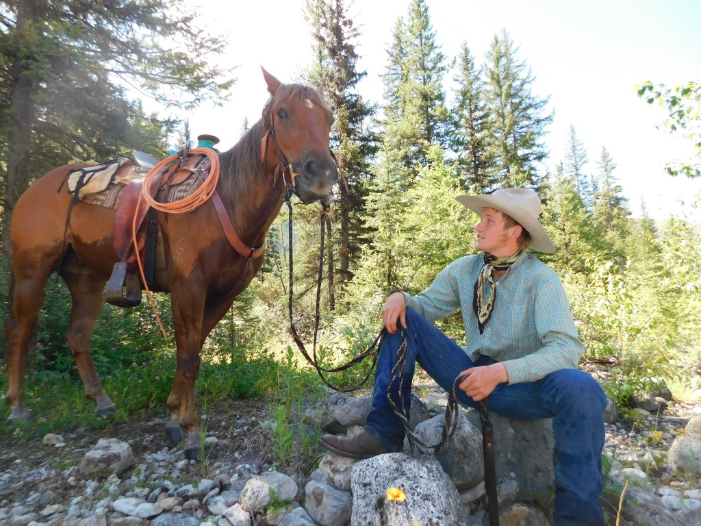 After chatting with Cinnamon along the river, we turned around and saw this scene. This was one of the favorite moments from my trip: just a cowboy hanging out, talking to his horse.