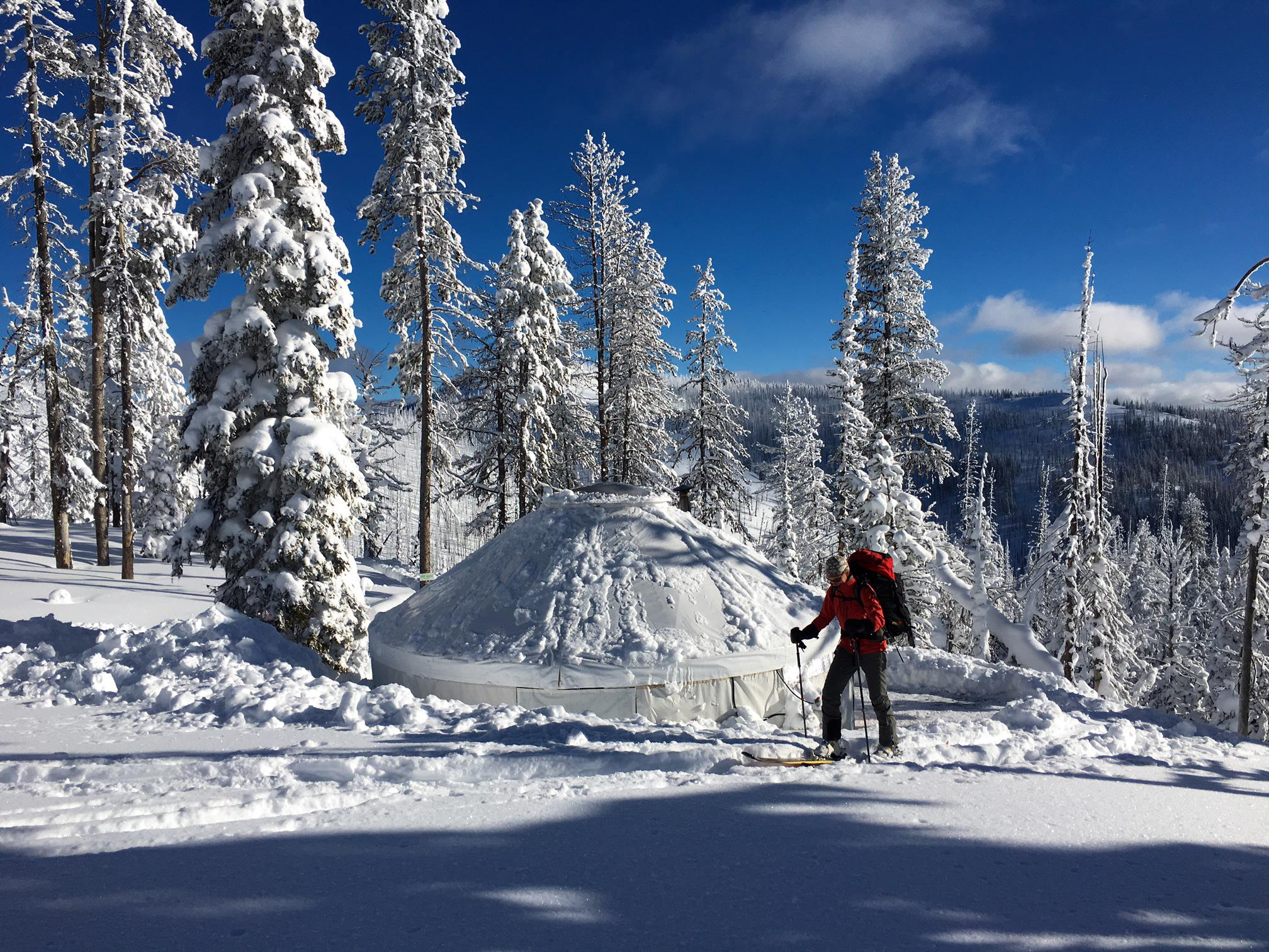 Embark on a Backcountry Ski + Yurt Experience in Western Montana