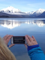 Capturing the view of Glacier's snow-covered peaks from Lake McDonald.