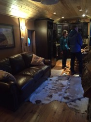 The living room in the luxury caboose.