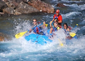 Navigating the rapids on the Middle Fork of the Flathead River.