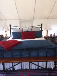 The bed inside the glamping cabin.