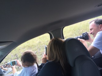 Three photographers exploring Montana. Sidenote: the car was in park, off and not moving when this picture was taken.