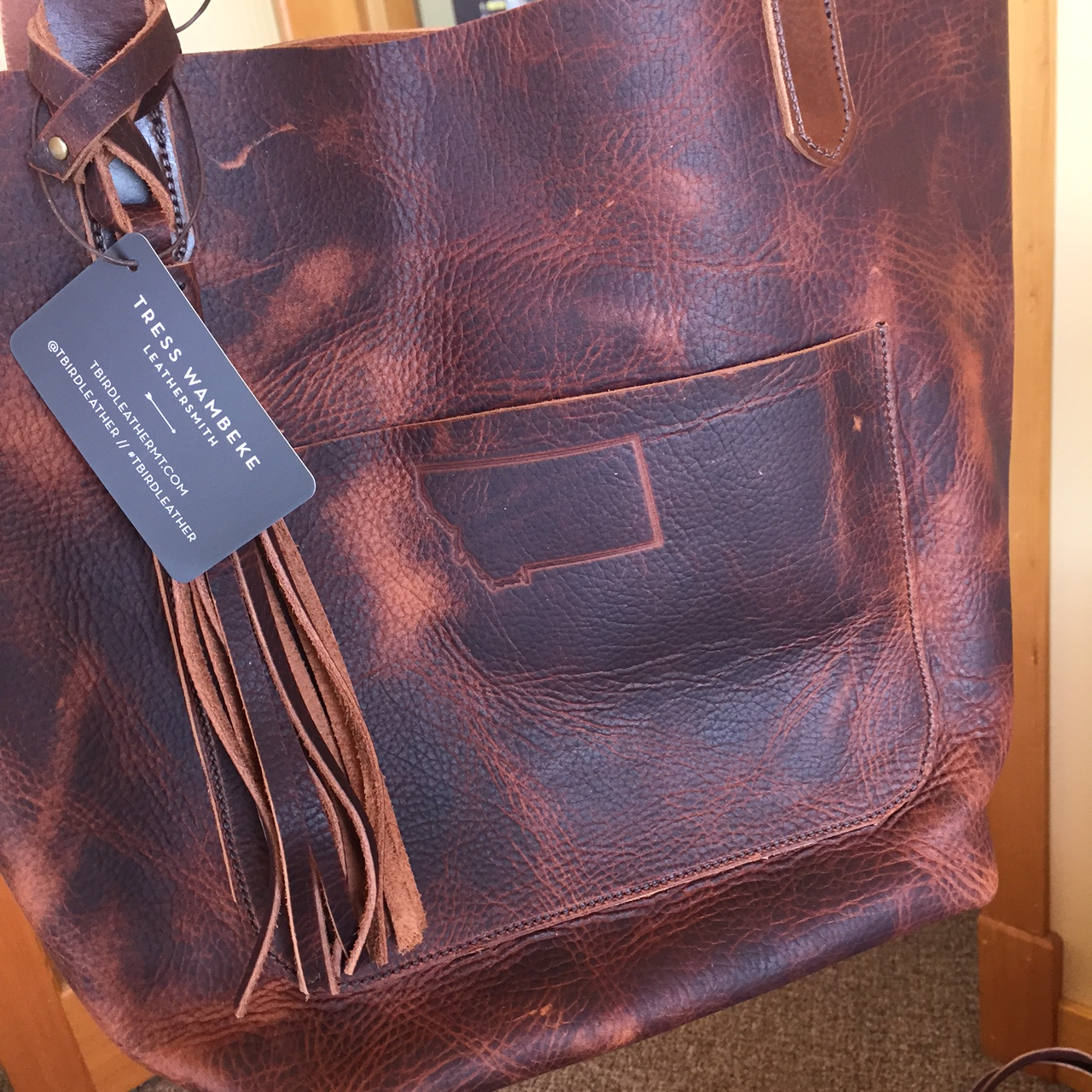 A T Bird Leather Tote (with a custom Glacier Country Montana brand).