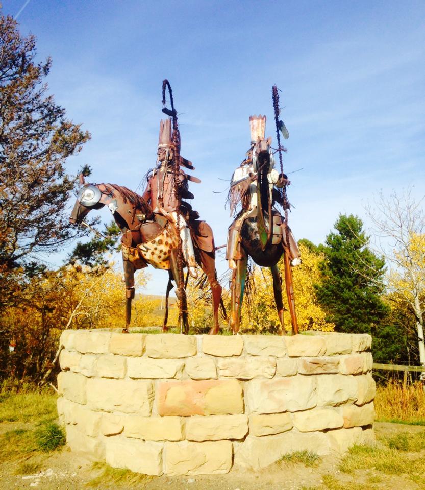 The warrior statues near East Glacier Park.