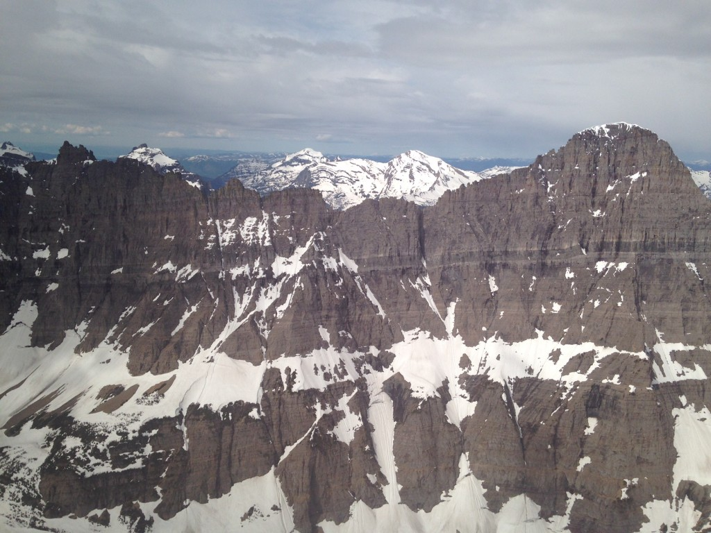 A bird's-eye view of the peaks of Glacier National Park in spring.