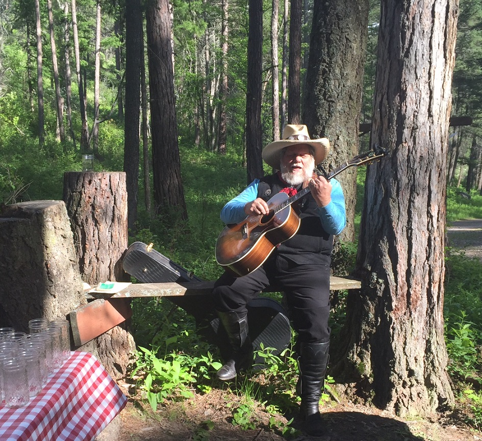 Cowboy singer-songwriter Gene filled the forest with his music.