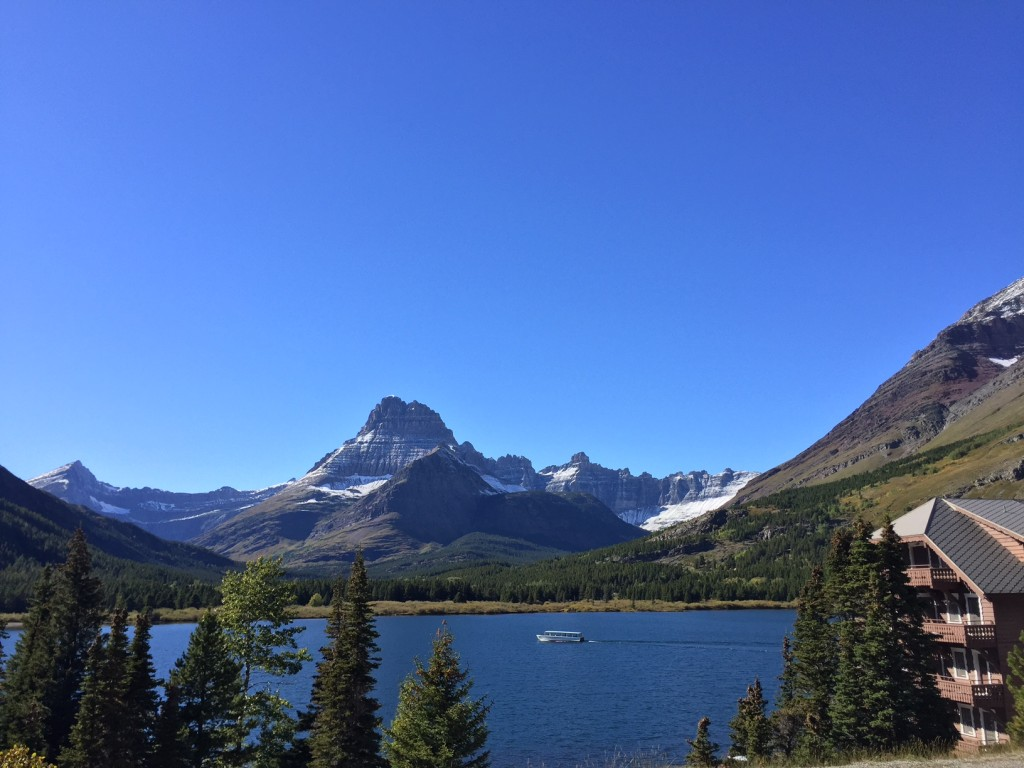 Two Guns (Glacier Park Boat Company's wooden boat) heading to the head of Swiftcurrent Lake.