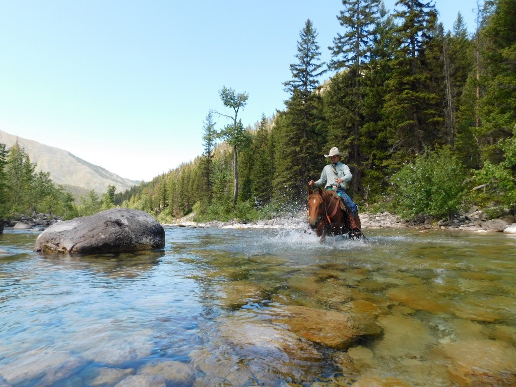 Turk (and his trusty steed) crossing White River.