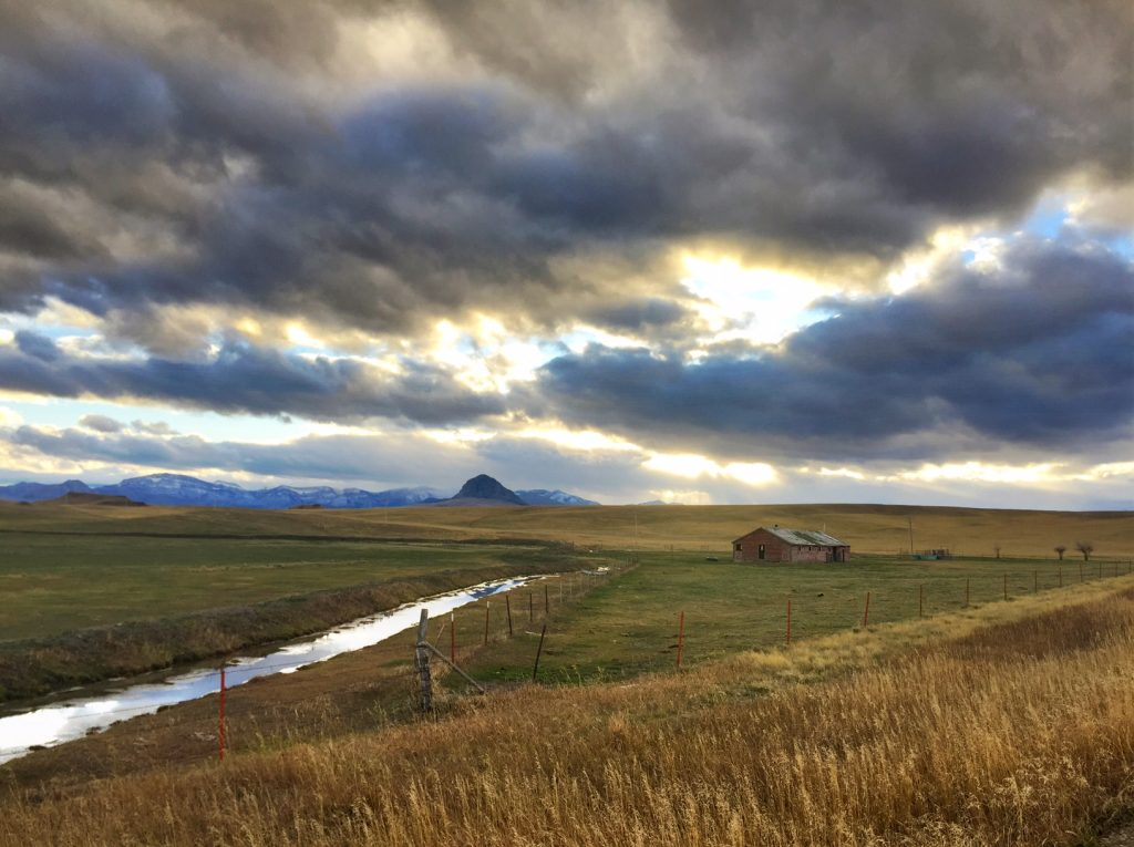 Wide-open spaces, an old barn and Haystack Butte.